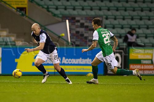 15th November 2020; Easter Road, Edinburgh, Scotland; Scottish League Cup Football, Hibernian versus Dundee FC; Charlie Adam of Dundee races away from Melker Hallberg of Hibernian