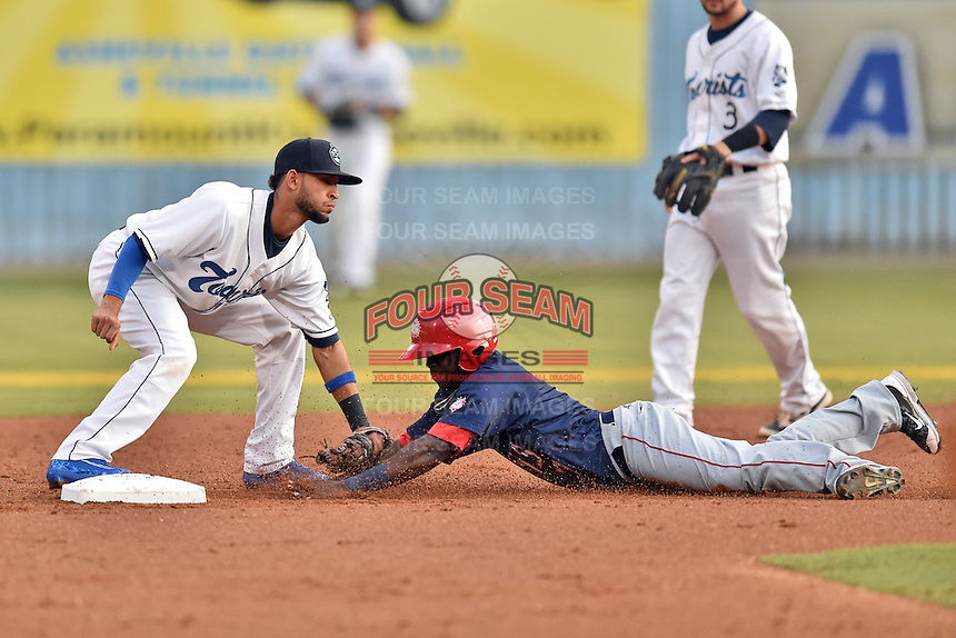 Asheville Tourists shortstop Carlos Herrera (4) fields the ball and tags out Telmito Agustin (7) during a game against the Hagerstown Suns at McCormick Field on September 4, 2016 in Asheville, North Carolina. The Suns defeated the Tourists 10-5. (Tony Farlow/Four Seam Images)