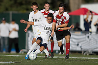 Akron's Anthony Ampaipitakwong (10) battles  Louisville's Dylan Mares (22) in the midfield. 2010 NCAA D1 College Cup Championship Final Akron defeated Louisville 1-0 at Harder Stadium on the campus of UCSB in Santa Barbara, California on Sunday December 12, 2010.