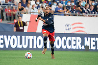FOXOBOROUGH, MA - AUGUST 21: Teal Bunbury #10 of New England Revolution brings the ball forward during a game between FC Cincinnati and New England Revolution at Gillette Stadium on August 21, 2021 in Foxoborough, Massachusetts.
