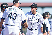 Peoria Javelinas third baseman Hudson Potts (13), of the San Diego Padres organization, shakes hands with manager Daren Brown (43) during player introductions before the Arizona Fall League Championship game against the Salt River Rafters at Scottsdale Stadium on November 17, 2018 in Scottsdale, Arizona. Peoria defeated Salt River 3-2 in 10 innings. (Zachary Lucy/Four Seam Images)