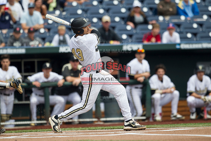 Vanderbilt Commodores first baseman Zander Wiel (43) follows through on his swing during the NCAA College baseball World Series against the Cal State Fullerton Titans on June 15, 2015 at TD Ameritrade Park in Omaha, Nebraska. Vanderbilt beat Cal State Fullerton 4-3. (Andrew Woolley/Four Seam Images)