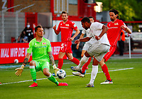 17th May 2020,Stadion An der Alten Försterei, Berlin, Germany; Bundesliga football, FC Union Berlin versus Bayern Munich; Serge Gnabry (2nd from right) of Bayern in shooting action against goalkeeper Rafal Gikiewicz (left) of Berlin who saved the shot