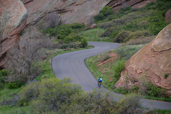 Man biking in Red Rocks State Park, Colorado