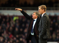 Sunday 07 December 2014<br /> Pictured L-R: West Ham manager Sam Allardyce gives further instructions to his players while Swansea manager Garry Monk stand impassive after suffering a 3-1 loss <br /> Re: Premier League West Ham United v Swansea City FC at Boleyn Ground, London, UK.