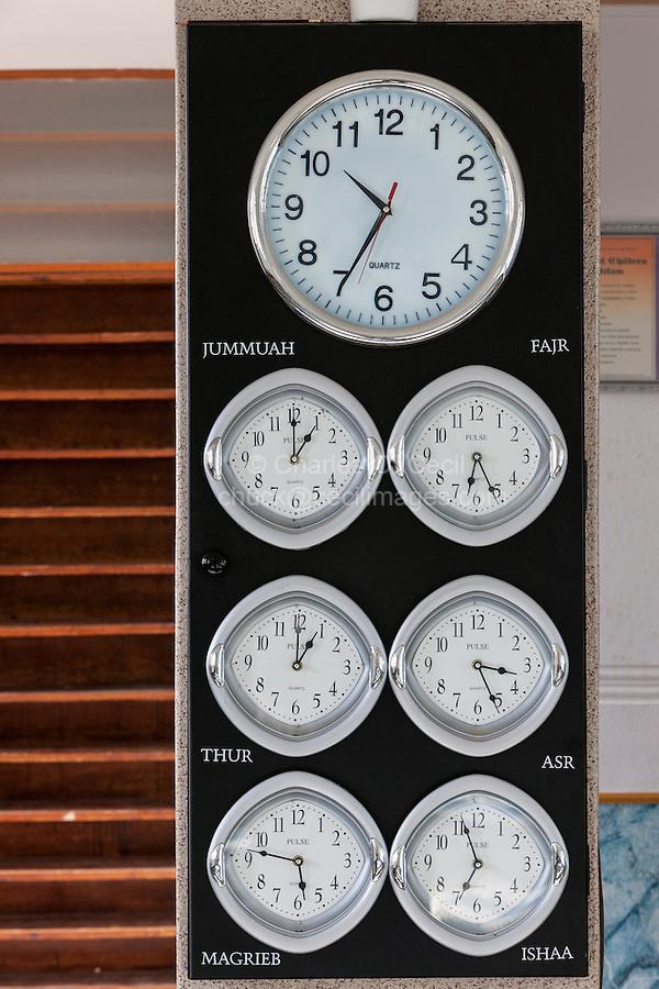 South Africa.  Cape Town, Bo-kaap.  Clocks Showing Prayer Times, Nurul Huda Mosque.
