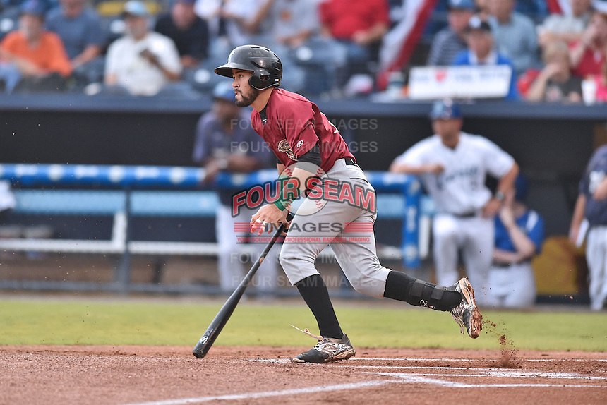 Savannah Sand Gnats shortstop Luis Guillorme (13) swings at a pitch during game one of the Southern Division South Atlantic League Playoffs against the Asheville Tourists on September 9, 2015 in Asheville, North Carolina. The Tourists defeated the Sand Gnats 5-1. (Tony Farlow/Four Seam Images)