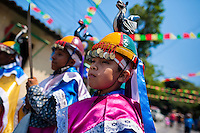 """Salvadoran boys, dressed as Moors and Christians, perform the traditional dance during the Flower & Palm Festival in Panchimalco, El Salvador, 8 May 2011. On the first Sunday of May, the small town of Panchimalco, lying close to San Salvador, celebrates its two patron saints with a spectacular festivity, known as """"Fiesta de las Flores y Palmas"""". The origin of this event comes from pre-Columbian Maya culture and used to commemorate the start of the rainy season. Women strip the palm branches and skewer flower blooms on them to create large colorful decoration. In the afternoon procession, lead by a male dance group performing a religious dance-drama inspired by the Spanish Reconquest, large altars adorned with flowers are slowly carried by women, dressed in typical costumes, through the steep streets of the town."""