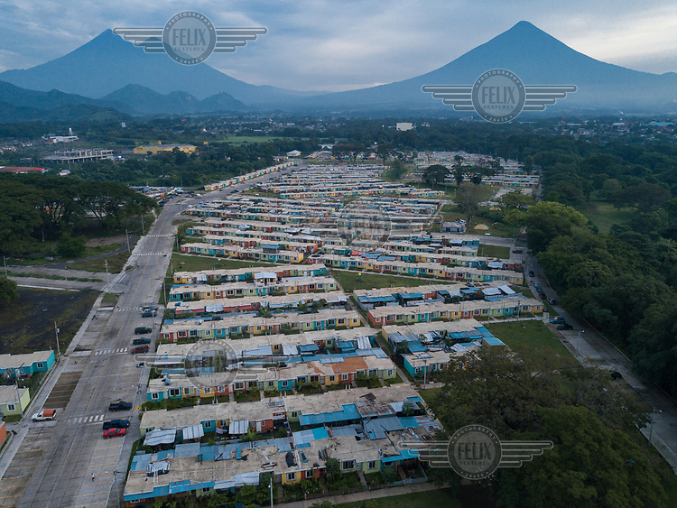 Aerial view of La Dignidad Housing Complex and, from left to right, the Fuego, Acatenango and Agua volcanoes. Except for 163 families from La Trinidad, who want the government to provide them with a landholding to continue their communal way of life, families from other uninhabitable communities began receving their homes in the La Dignidad Housing Complex during 2019.