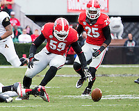 The Georgia Bulldogs beat the App State Mountaineers 45-6 in their homecoming game.  After a close first half, UGA scored 31 unanswered points in the second half.  Georgia Bulldogs linebacker Jordan Jenkins (59) goes after a fumble
