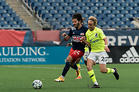 FOXBOROUGH, MA - MAY 12: Ryan Spaulding #34 of New England Revolution II brings the ball forward as Devin Boyce #20 of Union Omaha pressures during a game between Union Omaha and New England Revolution II at Gillette Stadium on May 12, 2021 in Foxborough, Massachusetts.