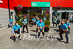 Squat Challenge : Members of the staff of the Listowel  Super Value store who are taking part in 2000 squat July challenge in aid of the Laura Lynn Childrens Hospital pictured outside Super Value on Saturday last.