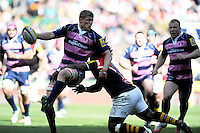 James Hudson of Gloucester Rugby offloads as he is tackled during the Aviva Premiership match between London Wasps and Gloucester Rugby at Twickenham Stadium on Saturday 19th April 2014 (Photo by Rob Munro)