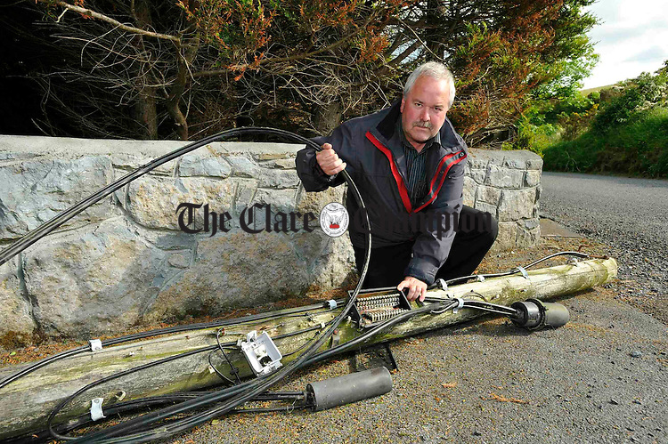 Martin Walsh with the telegraph pole at Magowna House Hotel. Photograph by John Kelly.