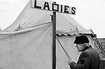 Derby Day Epsom Downs. The Ladies, this was a Ladies loo, a toilet tent, there would have been individual cubicles inside. 1969 1960s UK
