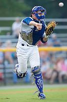 Catcher Josh Vittek (36) of the Burlington Royals fires a throw to first base at Burlington Athletic Park in Burlington, NC, Saturday, July 26, 2008. (Photo by Brian Westerholt / Four Seam Images)