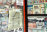 An old newspaper image of Eva Peron is displayed in a newsagents kiosk in downtown Buenos Aires.