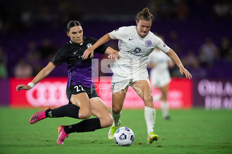 ORLANDO, FL - SEPTEMBER 11: Taylor Kornieck #22 of the Orlando Pride and Savannah McCaskill #7 of Racing Louisville FC battle for the ball during a game between Racing Louisville FC and Orlando Pride at Exploria Stadium on September 11, 2021 in Orlando, Florida.