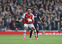 Arsenal's Pierre-Emerick Aubameyang and West Ham United's Jeremy Ngakia<br /> <br /> Photographer Rob Newell/CameraSport<br /> <br /> The Premier League - Arsenal v West Ham United - Saturday 7th March 2020 - The Emirates Stadium - London<br /> <br /> World Copyright © 2020 CameraSport. All rights reserved. 43 Linden Ave. Countesthorpe. Leicester. England. LE8 5PG - Tel: +44 (0) 116 277 4147 - admin@camerasport.com - www.camerasport.com