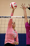 Marymount's Johanna Hummel attacks the ball in a college volleyball match against Shenandoah at Marymount University in Arlington, Vir., on Tuesday, Oct. 8, 2013.<br /> Photo by Cathleen Allison
