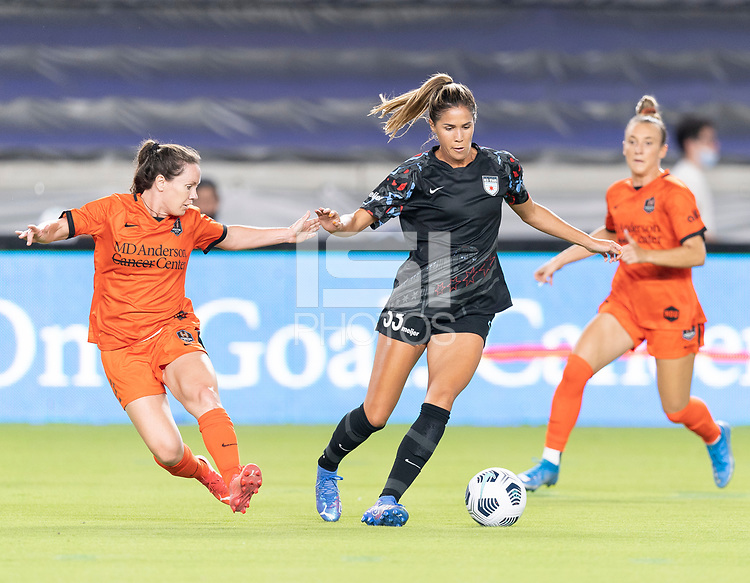 HOUSTON, TX - SEPTEMBER 10: Katie Johnson #33 of the Chicago Red Stars brings the ball up the field with Allysha Chapman #2 of the Houston Dash closing in on her during a game between Chicago Red Stars and Houston Dash at BBVA Stadium on September 10, 2021 in Houston, Texas.