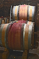 hammer tool on barrel barrel aging cellar domaine guyot marsannay cote de nuits burgundy france
