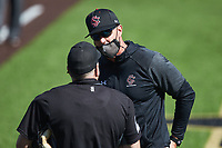 South Carolina Gamecocks head coach Mark Kingston argues with home plate umpire Fred Cannon after having been ejected from the game against the Vanderbilt Commodores at Hawkins Field on March 21, 2021 in Nashville, Tennessee. (Brian Westerholt/Four Seam Images)