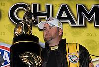 Nov 9, 2013; Pomona, CA, USA; NHRA top fuel dragster driver Shawn Langdon celebrates after clinching the 2013 championship following qualifying for the Auto Club Finals at Auto Club Raceway at Pomona. Mandatory Credit: Mark J. Rebilas-