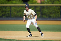 Shane Muntz (11) of the Wake Forest Demon Deacons takes his lead off of first base against the Virginia Cavaliers at David F. Couch Ballpark on May 19, 2018 in  Winston-Salem, North Carolina. The Demon Deacons defeated the Cavaliers 18-12. (Brian Westerholt/Four Seam Images)