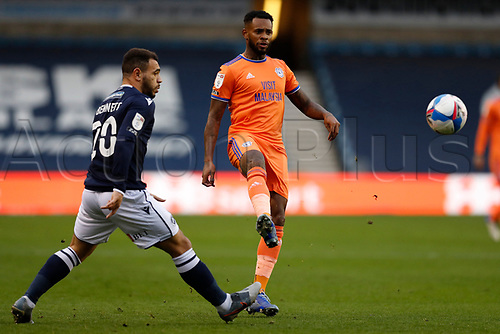21st November 2020; The Den, Bermondsey, London, England; English Championship Football, Millwall Football Club versus Cardiff City; Leandro Bacuna of Cardiff City crossing the ball with Mason Bennett of Millwall marking