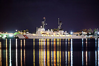 U.S. Coast Guard ship in the Honolulu Harbor at night, O'ahu