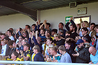9th October 2021;  VBS Community Stadium, Sutton, London; EFL League 2 football, Sutton United versus Port Vale; Sutton fans celebrates their team scoring a goal for 1-2