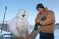 Volunteer comms/checker  checks in Cim Smyth at Kaltag on a cold 20 degrees below zero morning during Iditarod 2009