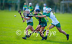 Kerry's Jessica Fitzell been tackled by Claire Coffey and Meave Clince of  Meath in the Camogie Intermediate Championship