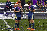 30th August 2020, San Sebastien, Spain;  Saki Kumagai and Eug nie Le Sommer of Lyon celebrates with trophy after winning the UEFA Womens Champions League football match Final between VfL Wolfsburg and Olympique Lyonnais 3-1