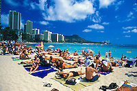 Famous  Diamond head & Waikiki beach lined with tourists on a sunny day