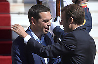 Pictured: French President Emmanuel Macron (R) and Greek Prime Minister Alexis Tsiptas embrace as they meet outside  Megaro Maximou (Maximou Mansion) in Athens, Greece. Thurday 07 September 2017<br /> Re: French President Emmanuel Macron state visit to Athens, Greece.