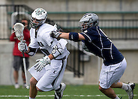 Collin Finnerty (20) of Loyola tries to go to goal past Eric Bicknese (5) of Georgetown at the Ridley Athletic Complex in Baltimore, MD.  Loyola defeated Georgetown, 11-6.