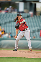 Sacramento River Cats starting pitcher Dereck Rodriguez (10) delivers a pitch to the plate against the Salt Lake Bees  at Smith's Ballpark on April 19, 2018 in Salt Lake City, Utah. Salt Lake defeated Sacramento 10-7. (Stephen Smith/Four Seam Images)