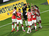 BOGOTA -COLOMBIA, 13- SEPTIEMBRE-2014. Jugadores de Independiente  Santa Fe celebran la victoria 4 goles por 1 contra   Millonarios  durante partido   de La Liga Postobón novena fecha 2014-2. Estadio  Nemesio Camacho El Campin   / Players of Independiente Santa Fe celebrate their victory against Millonarios  (R) of Independiente Santa Fe fights for the ball with XXXXX (L) of Millonarios  during La Liga match Postobón ninth date 2014-2.  Nemesio Camacho El Campin stadium . Photo: VizzorImage / Felipe Caicedo / Staff