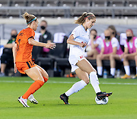 HOUSTON, TX - APRIL 09: Kayla Sharples #28 of the Chicago Red Stars keeps the ball in front of Veronica Latsko #12 of the Houston Dash during a game between Chicago Red Stars and Houston Dash at BBVA Stadium on April 09, 2021 in Houston, Texas.