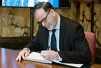 Former Parti Quebecois minister Pierre Duchesne signs a book of condolences during a memorial service for Lise Payette at City Hall in Montreal, Saturday, October 20, 2018. THE CANADIAN PRESS/Graham Hughes