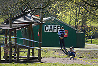 The public continue to leave homes & ignore Government guidelines as the weekend weather remains warm playing in children's playgrounds during the Covid-19 Pandemic in which the Government have given strict rules on only leaving the home for essential work, food shopping and one form of exercise per day.<br /> The Rye Park in High Wycombe, Bucks on 5 April 2020. Photo by Andy Rowland.