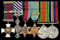 BNPS.co.uk (01202) 558833. <br /> Pic: Spink&Son/BNPS<br /> <br /> Pictured: The medal set awarded to Wing Commander Sidney 'Tubby' Baker. <br /> <br /> The bravery medals of a larger-than-life hero Pathfinder pilot who clocked up a staggering 100 bombing raids have emerged for sale for £32,000.<br /> <br /> Wing Commander Sidney 'Tubby' Baker, who was known for his love of food, drink and cigarettes, repeatedly risked his life in attacks on heavily defended German and Italian targets.<br /> <br /> Upon returning to his airbase after completing his century, the No 635 Squadron commander was handed a well-earned pint of beer and 'grounded with immediate effect'.<br /> <br /> As was his custom, he downed the drink and puffed on a celebratory cigarette.