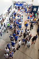 Chelsea FC fans line up to have their picture taken with the Champions League Trophy and FA Cup prior to the match between Chelsea FC and Paris Saint-Germain during the 2012 Herbalife World Football Challenge at Yankee Stadium in New York, NY, on July 22, 2012.
