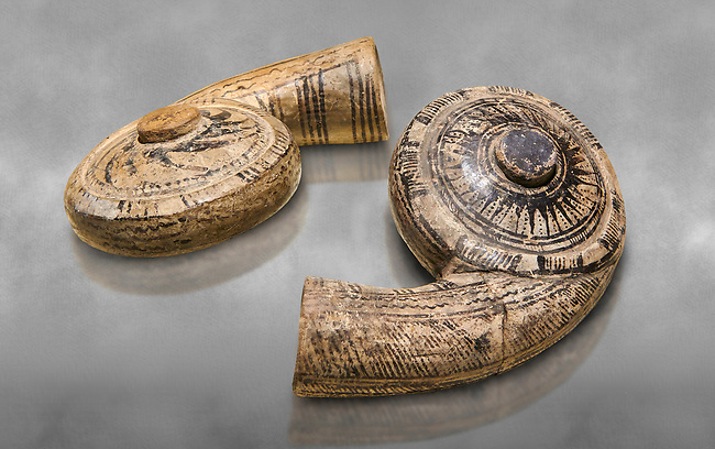 Two decorated terra cotta seashell shaped vessels found in the house of Assyrian trader, Elamma, at the second level of the Karum of Kultepe. - 19th to 17th century BC - Kültepe Kanesh - Museum of Anatolian Civilisations, Ankara, Turkey.