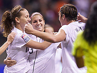 United States players Alex Morgan, center, Lauren Cheney, left, and Abby Wambach celebrate Morgan's goal against Costa Rica during play in the CONCACAF Olympic Qualifying semifinal match at BC Place in Vancouver, B.C., Canada Friday Jan. 27, 2012. The United States won the match 3-0 to earn a berth in 2012 London Olympics.