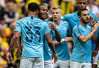 Raheem Sterling of Manchester City celebrates the 2nd goal scored by Gabriel Jesus of Manchester City during the FA CUP FINAL match between Manchester City and Watford at Wembley Stadium, London, England on 18 May 2019. Photo by Andy Rowland.
