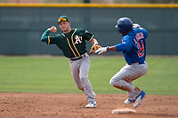 Oakland Athletics shortstop Nick Allen (1) makes a throw to first base in front of D.J. Wilson (24) during a Minor League Spring Training game against the Chicago Cubs at Sloan Park on March 13, 2018 in Mesa, Arizona. (Zachary Lucy/Four Seam Images)