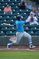 Tyler Alamo (13) of the Myrtle Beach Pelicans follows through on his swing against the Winston-Salem Dash at BB&T Ballpark on August 6, 2018 in Winston-Salem, North Carolina. The Dash defeated the Pelicans 6-3. (Brian Westerholt/Four Seam Images)